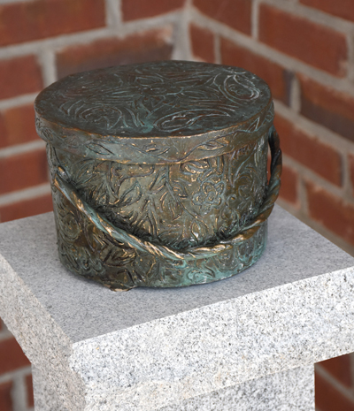 Bronze sculpture of a hat box