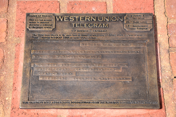 Bronze plate of telegram on brick